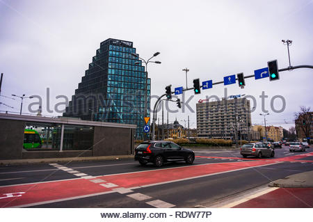 Poznan, Poland - November 21, 2018: Cars driving and passing green traffic lights on a intersection on the Swiety Marcin street and Roosevelta. Baltyk - Stock Image