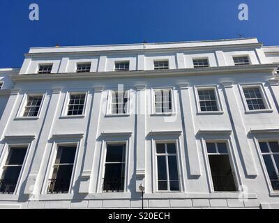 White stucco Regency terraced  housing in Royal Leamington Spa - Stock Image