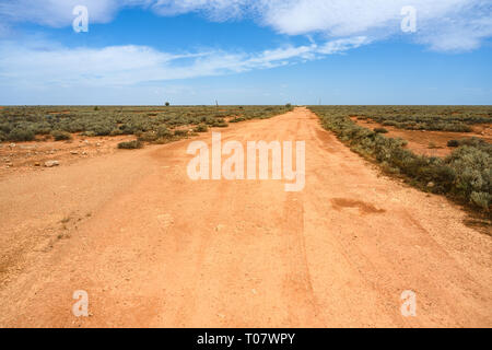 Unsealed gravel road at Cook, South Australia, a former railway town on the Nullarbor Plain that was largely abandoned in 1997. - Stock Image