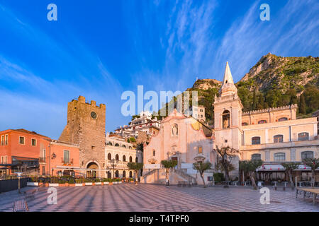 Morning square Piazza IX Aprile with San Giuseppe church, the Clock Tower and Mount Etna Volcano on background, Taormina, Sicily, Italy - Stock Image