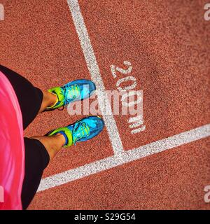 Female runner in front of 200 meters rce - Stock Image