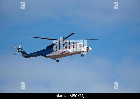 Bristows Sikorsky S-92 helicopter G-CGCI returning to the Aberdeen Heliport from a North Sea Oil Platform with change - Stock Image