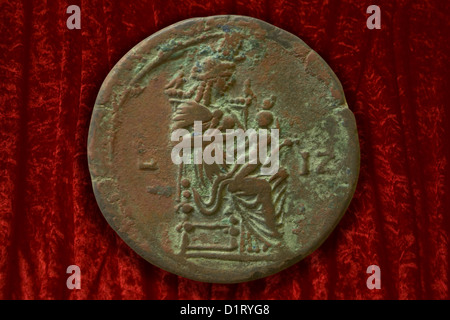 Bronze coin with Isis and her son Harpokrates - Stock Image