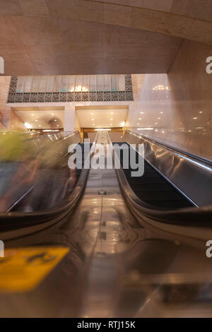 Passengers using the escalators to connect the Main Concourse, Grand Central Terminal, Manhattan, New York, USA - Stock Image