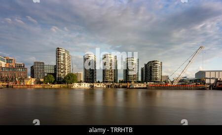London, England, UK - May 28, 2019: Evening sun shines on new build apartment buildings at Riverlight in the Nine Elms urban regeneration neighbourhoo - Stock Image