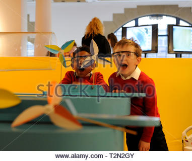 Edinburgh, UK. 3rd April, 2019.  Edinburgh, UK. 3rd April, 2019.  Omar and Colin from Royal Mile Primary School trying out wind turbine exhibits at ÒEnergy Makers Ò a new workshop at the City Art Centre (CAC) presented by the FestivalÕs headline sponsors, EDF Energy. Credit: Roger Gaisford/Alamy Live News - Stock Image