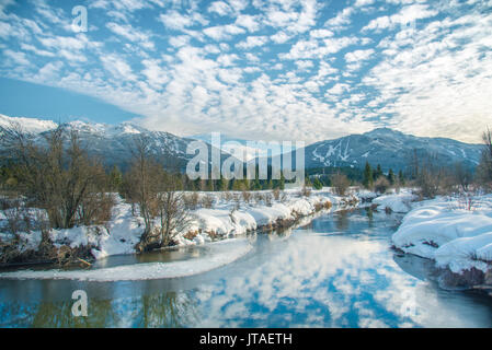 White clouds reflect over the River of Golden Dreams in Whistler, British Columbia, Canada, North America - Stock Image