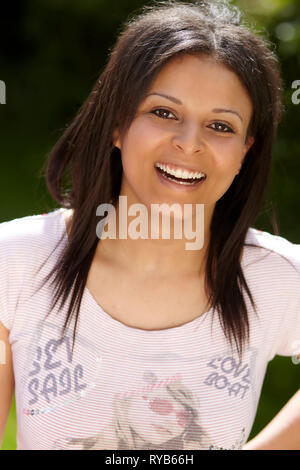 Portrait of attractive ethnic girl - Stock Image