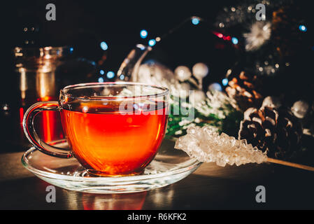 Tea cup still life; Cozy winter night time at home - Stock Image
