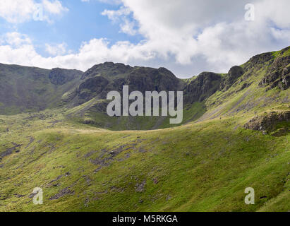 Summit of High Stile and Chapel Crags from the path leading to the summit of Red Pike in the English Lake District, - Stock Image