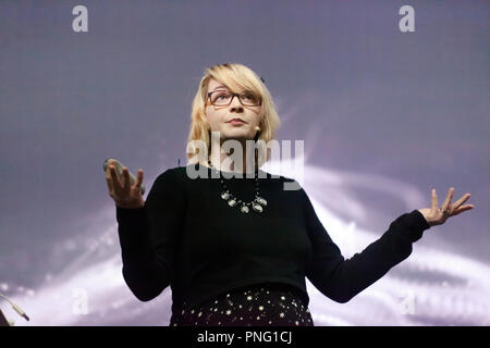 Astrophysicist Emma Chapman explaining what the first ever stars can tell us, on the Cosmos Stage, at New Scientist Live - Stock Image