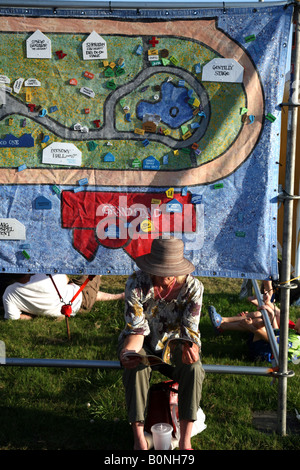 Woman takes a break at the New Orleans Jazz & Heritage Festival, May 2008, New Orleans, LA, USA - Stock Image