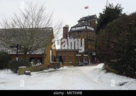 The Brewery, after a March snowfall, Hook Norton, Oxfordshire - Stock Image