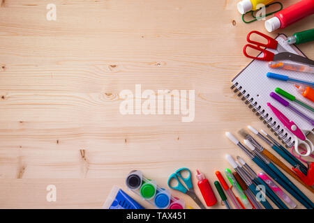 School supplies on wooden background ready for your design - Stock Image