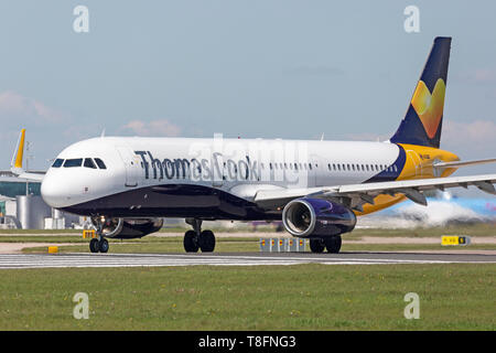 Thomas Cook Airlines Airbus A321-200, registration G-TCVC, preparing for take off from Manchester Airport, England. - Stock Image