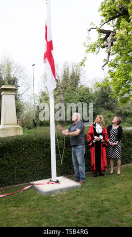 Biggin Hill, UK. 23rd Apr, 2019. Mayor of Bromley, Kim Botting, unveils a New flagpole in Biggin Hill Kent by the War memorial. The flag of St George was proudly flown after a short ceremony to remember England's patron Saint. Local dignitaries and local residents attended to see the ribbon cutting and flag flown. Alan Everett has agreed to fly the Union Jack daily. Credit: Keith Larby/Alamy Live News - Stock Image