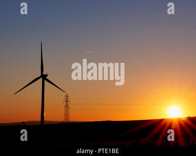 Harborough Rocks wind farm, Peak District, UK. 9th October, 2018. UK Weather spectacular sunset at Harborough Rocks wind farm after an unusually warm October day in the Peak District National Park due to climate change & global warming Credit: Doug Blane/Alamy Live News - Stock Image