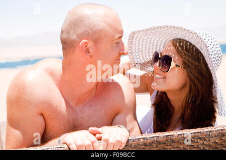 Happy love couple enjoying themselves on the beach - Stock Image