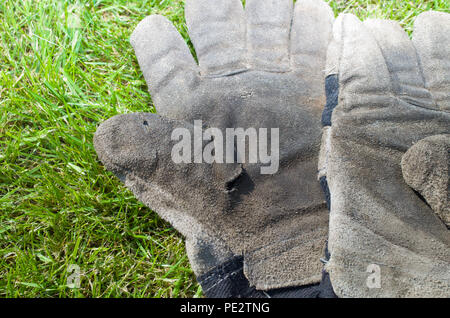Gloves PPE Worn Old Used Protective Protection UK - Stock Image