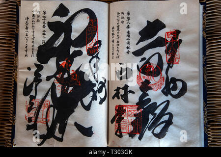 Nokyocho are booklets for having each of the 88 temples on the Shikoku Pilgrimage trail to put the temple's official seal and artful calligraphy into  - Stock Image
