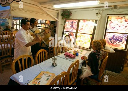 Spain Baleares island Ibiza town by night restaurants near harbour Sa Penya street musicians - Stock Image