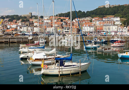 Boats moored in the harbour. - Stock Image