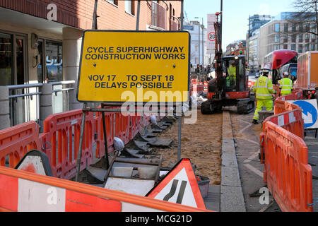 Cycle superhighway construction works sign and workers working on Clerkenwell Road in London UK  KATHY DEWITT - Stock Image