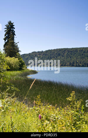 St. Mary's Lake on Salt Spring Island, British Columbia, Canada.  Beautiful lake on one of the Southen Gulf Islands. - Stock Image