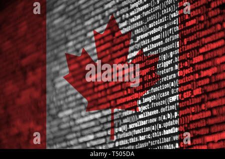 Canada flag  is depicted on the screen with the program code. The concept of modern technology and site development. - Stock Image