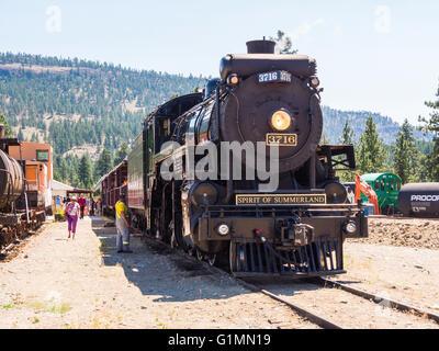 1912 steam locomotive 3716, 'Spirit of Summerland, pulls a train on the Kettle Valley Steam Railway, near Summerland - Stock Image