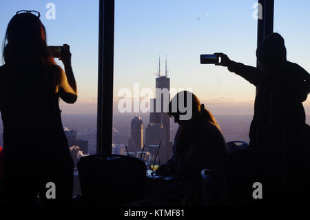 Tourists take photos with their phones from the obsersation deck on the John Hancock building. Chicago, Illinois, - Stock Image