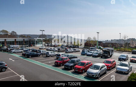 Waitrose supermarket  store in Sidmouth Devon. High above the seaside town, you can see the sea from it's car park. - Stock Image