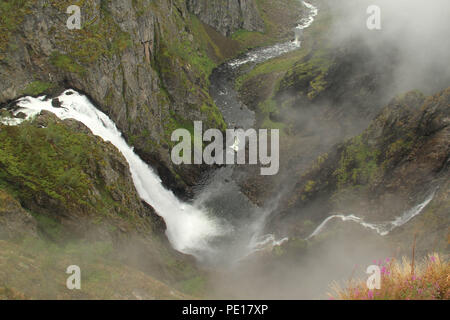 Voringsfoss, Norway - 5 August 2018: General view of the Voringsfoss Waterfall which is about 20 minute drive from the village of Eijford in the fjords of Norway on 6 August 2018. The waterfall located by the Fossil Hotel has a drop of 183 m ( 600ft) in a canyon below. Photo: David Mbiyu - Stock Image