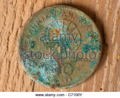 Old Greek money Drachma coin Greece with corrosion - Stock Image