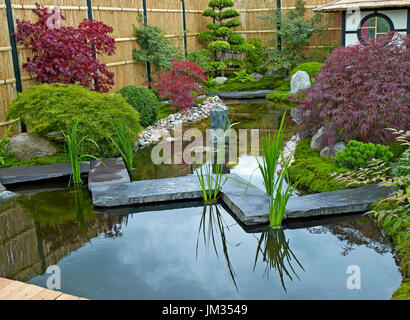 Garden in the style of a Japanese Tea Garden with traditional planting - Stock Image