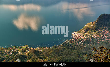 beautiful aerial view on the Maggiore Lake in autumn season with clouds reflected on the water - Stock Image