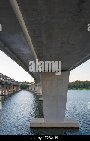 The dual Iron Cove Bridges that join the Sydney suburbs of Drummoyne and Rozelle over the upper reaches of Sydney harbour. - Stock Image