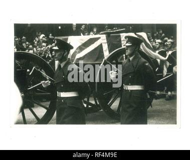 Winston Churchill's horse drawn coffin with draped flag and military men with gun walking beside through crowd 30th January 1965- Social History - Stock Image