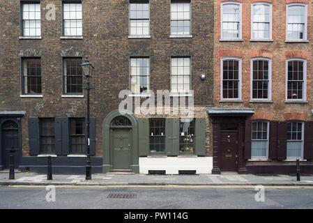 Georgian terraced town houses in Wilkes Street, London, England, UK - Stock Image