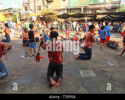 Navotas City, Philippines. 4th Jan, 2012. Flagellates seen whipping their backs at the front yard of the chapel during Good Friday. Credit: Josefiel Rivera/SOPA Images/ZUMA Wire/Alamy Live News - Stock Image