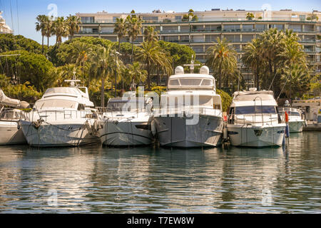 CANNES, FRANCE - APRIL 2018: Luxury motor yachts lined up in the Port Pierre Canto marina in Cannes - Stock Image
