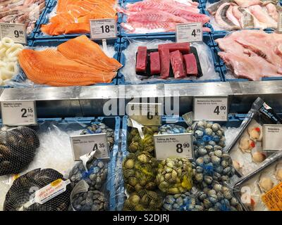 Fresh fish and seafood stall in a supermarket, Spain - Stock Image