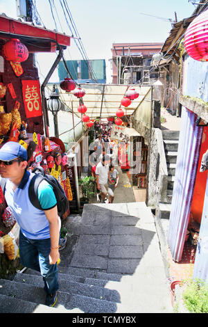 JIUFEN, TAIWAN - JUL 14, 2014: Visitors mingle at the shops of historic Jiufen Old Street, a bustling mountain town famous for its quaint narrow stree - Stock Image