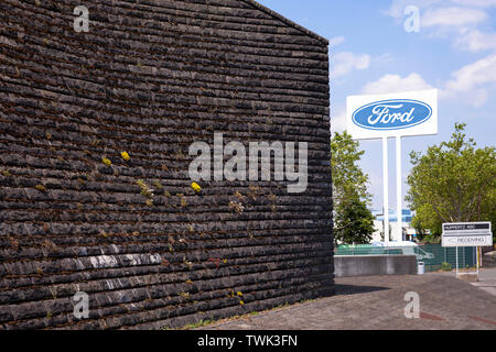 basalt facade of the flood pumping station at the river Rhine in Koeln-Niehl, the vegetation of the wall with moss and other plants is intentional, AS - Stock Image