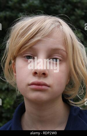 Portrait of a pale unhappy tired listless young blond girl - Stock Image