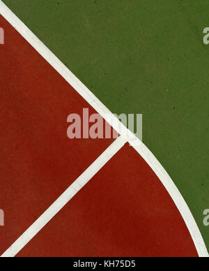 Pole aerial image of an outdoor basketball court. Includes red key, white lines, green surface and triangular shapes. - Stock Image