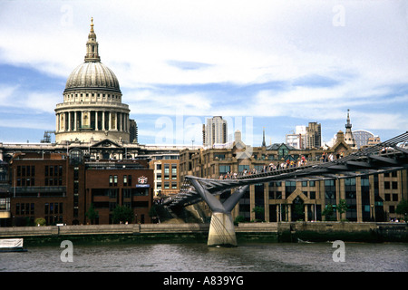 Millennium footbridge and St Paul s Cathedral London - Stock Image