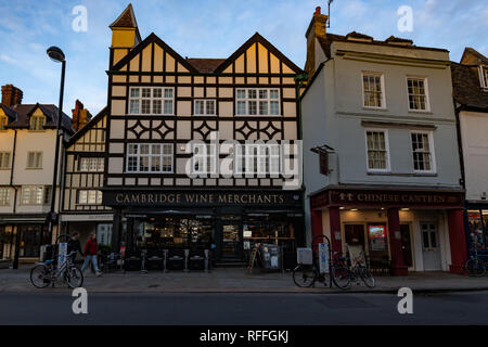 A Tudor building in Cambridge town centre at sunset - Stock Image