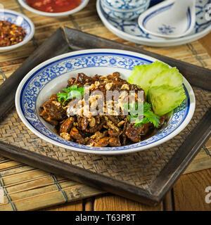 Thai fried pork with garlic. Moo tod gratiem. Thailand Food - Stock Image