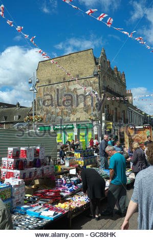 Market day in the High Street of Dartford, with the Dartford Industry Mural visible. Dartford, Kent, UK. - Stock Image
